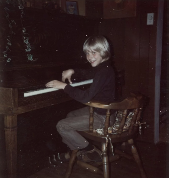 Kurt Cobain, pictured playing the piano aged eight in 1975, in a photograph that will form part of an exhibition of his personal items at Museum of Style Icons in Newbridge, Ireland. Photo: Cobain Family Archive.